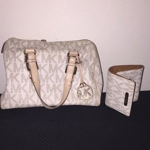 A Set of Michael Kors Purse And A Matching Wallet